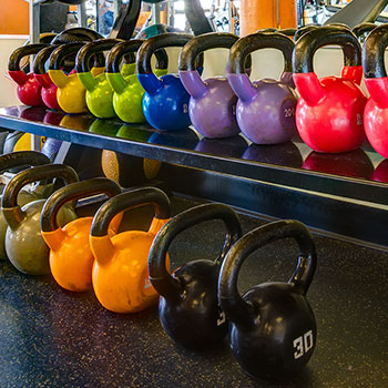 We have colored dumbbells in our Denver, Colorado gym.