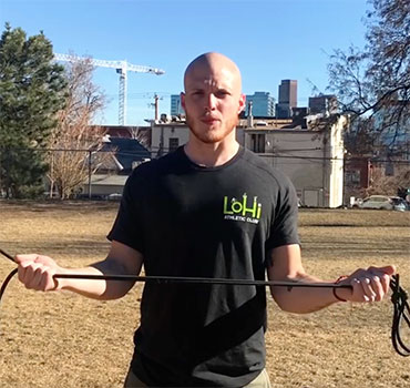 Trainer and Kinesiology expert, Garrett Ziegler , of LoHi Athletic Club in Denver, Colorado, demonstrates exercises with a resistance band
